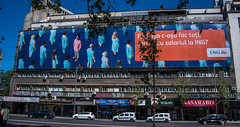 2018 - Romania - Bucharest - Cover Up (Ted's photos - For Me & You) Tags: 2018 bucharest nikon nikond750 nikonfx romania tedmcgrath tedsphotos vignetting streetscene street vehad advertisement ing politia bucharestpolitia politiabucharest bucharesti bucharestromania pepsi signs bollards red redrule building