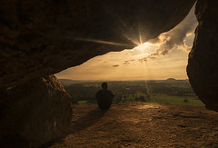 """There's a silence surrounding me, I can't seem to think straight,I'll sit in the corner, no one can bother me."" (swearingpirate) Tags: hampi landscape travel cave frame sunset fantasy sunrays rocks earth"