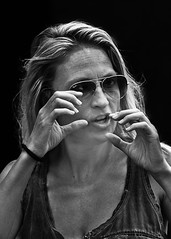 Portrait (D80_507730) (Itzick) Tags: denmark copenhagen candid bw streetphotography shades face facialexpression woman youngwoman portrait d800 itzick blackbackground