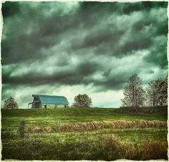 Hilltop barn.... (Sherrianne100) Tags: rural farm stormy clouds fence landscape oldbarn barn hills ozarks missouri