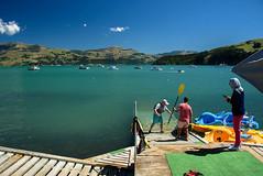 Having Fun in the Water (Jocey K) Tags: bankspeninsula newzealand nikond750 akaroa hills sea akaroaharbour scene seascape clouds sky people boats shadows water kayak