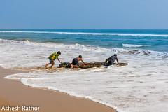 Push push push (asheshr) Tags: 18140mm beach beachphotography d7200 fishingboat havingfun kidsplaying nikkon nikkond7200 nikkor18140mm odisha orissa sea seascape seashore surf