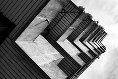 Side Rise (sawyersource) Tags: minimalism minimal minimalist brutalism brutalist architecture building 1960s 60s 60sarchitecture d7200 35mmlens nikon nikkor blackandwhitephotography blackandwhite bnwphotography bnw bw concrete upshot angles sideways urban