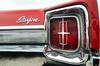 Starfire tail light (GmanViz) Tags: gmanviz color car automobile vehicle detail chrome nikon d7000 1965 oldsmobile starfire taillight bumper trunklid badge script type