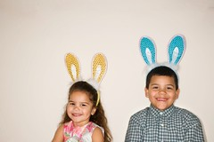Kids wearing bunny ears. (perfectionistreviews) Tags: color horizontal copyspace easter holiday 34years daughter girl child 79years boy son twopeople family brother sister caucasion hispanic eyecontact smiling indoors costume easterbunny rabbitears ears festive customs traditions headandshoulders fun happiness playfulness bunnyears cute adorable latino happy smile holidaysandoccasions