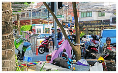 Busy... - Phuket, Thailand (TravelsWithDan) Tags: candid streetphotography people outdoors beachside street motorbike couple busy phuket thailand canong3x ngc
