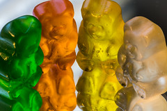 Gummi bears gather to reflect on the state of the gummi world (sniggie) Tags: macromondays candy gummi gummibears macrophotography mirror reflection