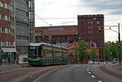 "Helsinki City Transport (HKL-Raitioliikenne) Transtech ""Artic"" tram 444 at Käenkuja stop on Hämeentie on 18 May 2018 (Trains and trams eveywhere) Tags: transtech helsinki finland tram tramways articulated 3car electric green artic brandnew interior lowfloor raitiovaunua madeinfinland kotimainen hkl helsinginkaupunginliikennelaitos hklratioliikenne hämeentie trafficlight"