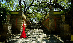 The woman in the red dress. (Aglez the city guy ☺) Tags: womensmodels models red park gardens trees people vizcayamuseumgardens outdoors urbanexploration walkingaround miamifl architecture