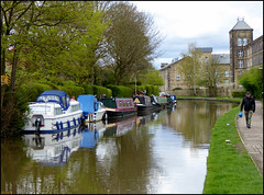 Cloudy morning along the canal. (Country Girl 76) Tags: canal leeds liverpool skipton yorkshire water boats reflections buildings people tower converted mill clouds towpath trees