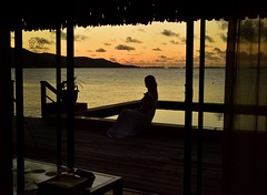 Room with a View  (Bora Bora) (Harald Philipp) Tags: outdoors panorama seascape landscape orangesky natural scenic woman silhouette balcony terrace terrasse deck window roomwithaview swimmingpool pool thatchedroof hotel villa ocean sea lagoon bay water mountain volcano reef hill paradise holiday vacation tourism luxury tourist exotic tropicalisland destination travel adventure island beautiful romantic dark shadows contrast nikon nikkor d810 dusk twilight sunset cloud clouds reflection mirror southpacific borabora pacificocean frenchpolynesia polynesia