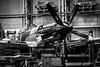Service and MOT (aquanout) Tags: blackandwhite monochrome spitfire aeroplane airplane aircraft hangar workshop plane propellor
