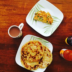 Vegetable and Cheese Omelette with Paratha and Chocolate Milk (Emaad Paracha) Tags: eats beef roti chicken seafood paratha egg omelette octopus chimichurri naan chai tea hotdogs pancakes fish chips burger cookies wraps shawarma ox coffee cake bun kabab pizza hollywood bollywood korean food dessert milkshake crepe potluck