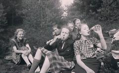 Lunch in the Woods (TrueVintage) Tags: oldphoto vintagephoto foundphoto people vintagepeople teenager girls vintageteenager mädchen jugendliche flasche bottle trinken drinking eating essen wald pause break rock skirt röcke skirts