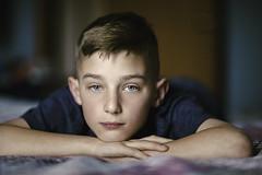 (Rebecca812) Tags: boy child portrait adolescence bedroom calm serene serenepeople boyhood realpeople authentic canon rebeccanelson rebecca812 quilt blueeyes eye detail closeup headandshoulders
