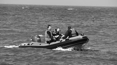 Having fun on the water 01 (byronv2) Tags: sunny sunlight sunshine spring musselburgh eastlothian northsea sea river riverforth firthofforth rnbforth rnbfirthofforth forth peoplewatching candid street blackandwhite blackwhite bw monochrome coast coastal edinburgh edimbourg scotland boat vessel inflatable man men sailing inflatableboat speedboat rib fisherrow