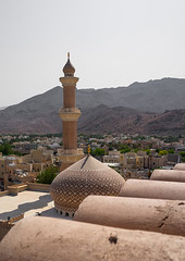 Al qala'a mosque seen from the fort, Ad Dakhiliyah Region, Nizwa, Oman (Eric Lafforgue) Tags: alqalaa arabworld arabia arabianpeninsula arabic arabicarchitecture arabicstyle architecture city colorimage copyspace cult cultures day dome faith gulfcountries islam minaret mosque nizwa nopeople oman oman18303 outdoors placeofworship religion sultanate traveldestination traveldestinations vertical addakhiliyahregion
