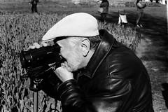 Video camera man. (autoworks31) Tags: trix400 tx400 kodak gsn yashicaelectro35 bnw streetphotography streetphotographer festival tulip ottawa
