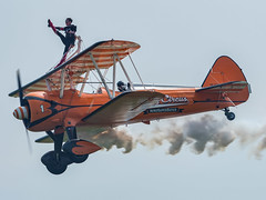 Aerosuperbatics Wingwalker (davepickettphotographer) Tags: boeing stearman duxford iwm theimperialwarmuseumuk imperialwarmuseum daredevil wingwalkers wingwalking airshow aircraft cambridgeshire cambridge may aerosuperbatics wingwalker