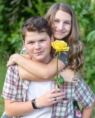 Siblings (Aaron A Baker) Tags: siblings nia flower rose yellow happy park portrait