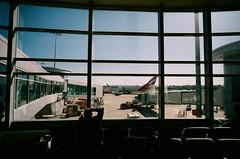 Airport Lounge (0zufan) Tags: voigtlander 21mm color skopar airport lounge qantas fujifilm industrial 100 sky plane aeroplane film analog analogue 747 bessa sydney tarmac