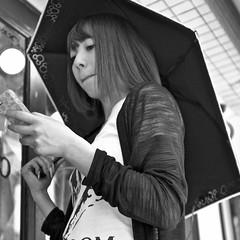 harajuku, japan (michaelalvis) Tags: asia bw blackandwhite candid city citylife cellphones fujifilm harajuku japan japanese japon monochrome nihon nippon portrait peoplestreet people peoplestreets parasol streetphotography streetlife street travel tokyo urban umbrella women x70