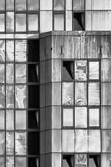 dingy even sunlit (janemetcalfe13) Tags: portsmouth facade windows dreary monochrome architecture dingy dirty building reflection