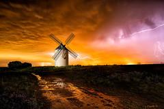 Land Of Passion. (darklogan1) Tags: lighting windmill thunderstorm reflection yellow orange dramatic guadalajara lamancha sonyilce7rm3 sonyfe1635mmf28gm longexposure nightphotography lightpainting bolts logan darklogan1 clouds night rain