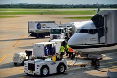 Airport Crews and Equipment Getting a Flight Ready
