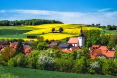 Springtime in Unteralterheim (Naïve Art Version) (Claudia G. Kukulka) Tags: altertheim unteraltertheim village dorf spring frühling rapeseed rapsfelder church kirche martinskirche