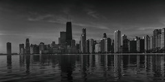 Chicago skyline (jbarc in BC) Tags: chicago skyline city skyscrapers monotone bw lake lakemichigan sky clouds reflections illinois dawn sunrise ripples water buildings downtown