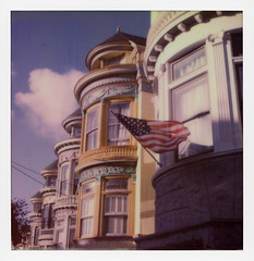 Haight Flag (tobysx70) Tags: polaroid originals color 600 instant film slr680 haight flag central avenue san francisco california ca houses stars tripes us usa old glory red white blue sky clouds polavacation 042818 toby hancock photography
