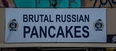 2018 - Romania - Bucharest - Brutal Eh? (Ted's photos - Returns 23 Jun) Tags: 2018 bucharest nikon nikond750 nikonfx romania tedmcgrath tedsphotos vignetting sign brutalrussianpancakes wideangle widescreen