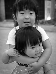 Hoi An-Sisters (Gilama Mill) Tags: street vietnam hoian love kids children blackandwhite sisters sister girls