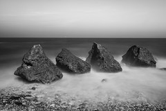 On The Rocks (Dean Conley) Tags: trowrocks rocks sea southshields nikond3400 nikon d3400 tokina1120mm tokina longexposure lee leefilters bigstopper 10stopnd dslr shore seascape flickr blackandwhite bw monochrome mono northeastengland englishcoast thisisengland pebbles outdoors shuttercontrol