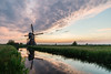 Colourful clouds at Broekmolen. (Rob Schop) Tags: f11 spring grootammers landscape sunset sonya6000 molens nederland outdoor clouds skyscape nd64 sigma30mm14 red lente windmill a6000 zonsondergang wolken colour hoyaprofilters
