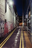 Yellow Leading through the Night (Thomas Listl) Tags: thomaslistl color london uk greatbritain urban alley street night evening dark graffiti facade lines yellow streetlamp wet rainy mood atmosphere ngc 35mm