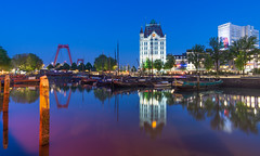 Blue hour with a bit of red (Rob Schop) Tags: oudehaven willemsbrug le bluehour reflectie blauweuurtje rotterdam samyang12mmf20 nederland outdoor a6000 city wideangle sonya6000