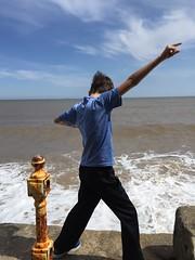 Striking a pose on Bridlington sea wall (andypf01) Tags: people male child boy posing sea waves bluesky seawall bridlington england unitedkingdom uk colour outdoor play fun apple iphone6 eastriding yorkshire