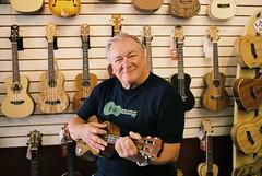 Ukulele Man (David Swift Photography) Tags: davidswiftphotography portraits filmportraits ukulele shops stores musicians music musicalinstruments 35mm film nikonfm2