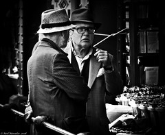 Time travel is impossible. (Neil. Moralee) Tags: neilmoralee neilomoralee old man men mature talk talking street candid hat hats glasses contrast dark harsh black white blackandwhite monochrome moody sinister bristol uk neil moralee olympus omd em5 time travel science fiction