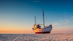 On a Sea of Sand (Matt Rimkus Photography) Tags: jammerbugt beach sunset goldenhour denmark northsea fishingboat warmtones bluesky slettestrand