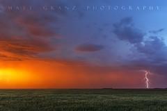 A Distant Strike (Matt Granz Photography) Tags: sunset clouds storm lightning lightening field plains grass nikon mattgranz nature