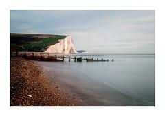 Evening-light-SevenSisters-Sussex (jdtphotographycouk) Tags: sevensisterscliffs sussexcoast sunlight ukcoast pentax pentaxk7 clouds sea longexposure groynes beach pebbles coastalphotography bwfilter nd110 seascape