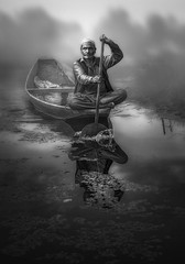 *** (tchakladerphotography) Tags: lake dal kashmir boat light people person atmosphere mood tradition reflection