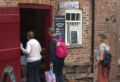 Bakery Talbot Yard, Malton (Tony Worrall) Tags: talbotyard malton yorkshire yorkshirephotos yorks northyorkshire town foodfestival event foodies update place location uk england north visit area attraction open stream tour country item greatbritain britain english british gb capture buy stock sell sale outside outdoors caught photo shoot shot picture captured bakery people shop doorway candid shoppers peek