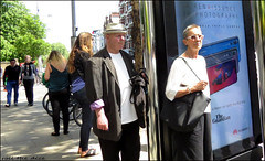 `2296 (roll the dice) Tags: london kensington w8 hot sunny weather people fashion streetphotography reaction shops shopping surreal fun funny bored happy canon tourism tourists mad sad busstop travel park transport royal advertising portrait candid strangers uk art classic england urban unaware unknown guardian glasses newspaper media press huawei