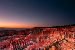 Nature's arena (Sony J Thomas) Tags: brycecanyon utah moon landscape goldenhour colorful sunrise