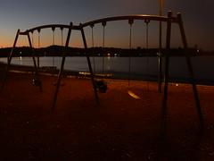 Dusk Swings (mikecogh) Tags: paihia disk shore swings playground sea