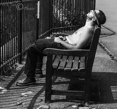 Catching Some Rays-03238 (G.K.Jnr.) Tags: candid street streetphotography outdoor people portraits strangers bench seat railings monochrome bw blackandwhite blackwhitephotos urban folkestone kent unitedkingdom fujix apsc xt1 pavement sidewalk
